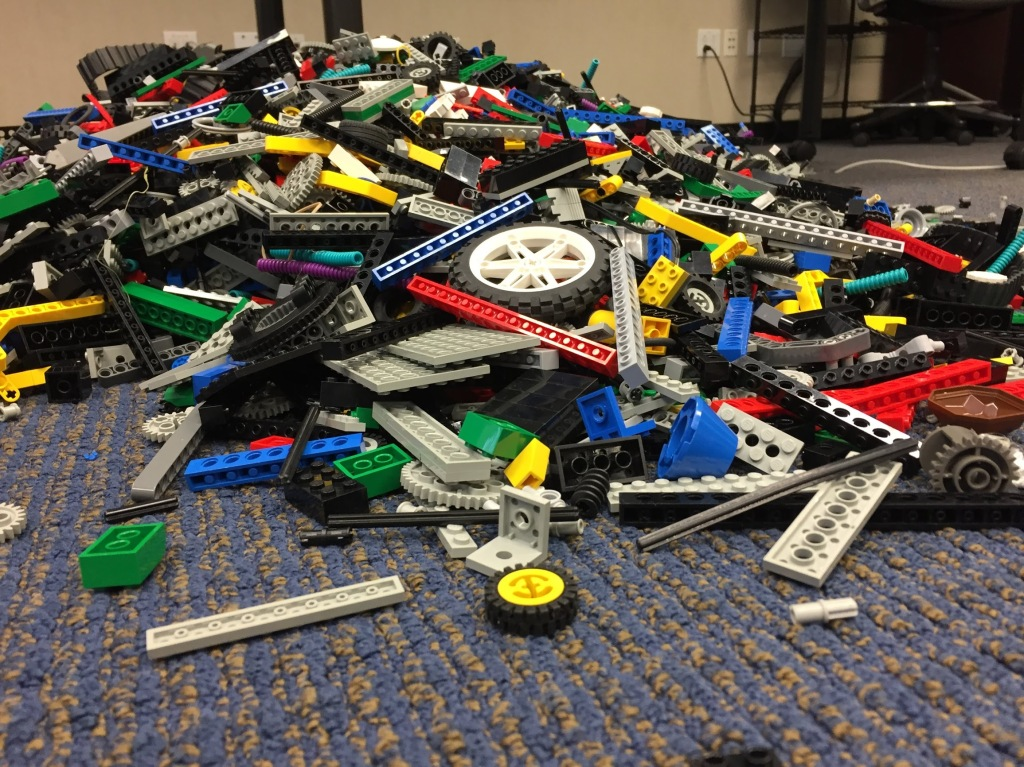 A pile of legos on the floor.